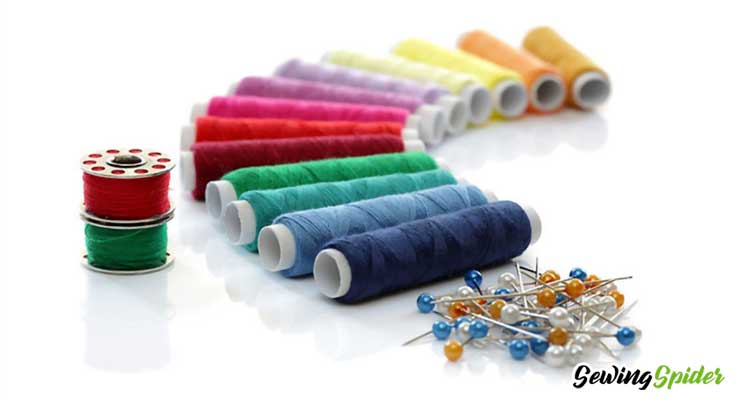 Sewing thread with pin and bobbin