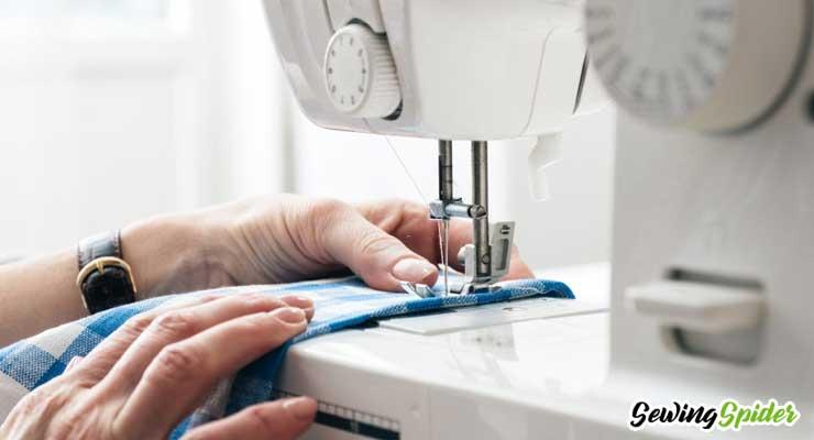a man sew a blue shirt